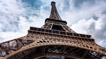 eiffel tower at cloudy sky, france, paris