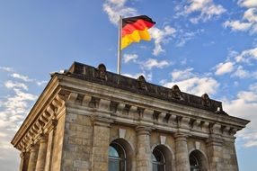 flag at sky on bundestag building, germany, berlin