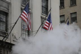 flags of America in fog in New York