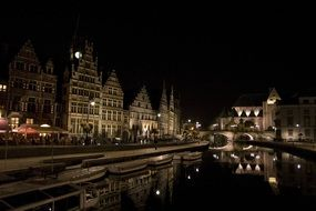 channel in old town at night, belgium, ghent