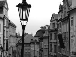 Black and white photo of a lantern on the street