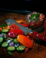knife and fresh colorful vegetables on table
