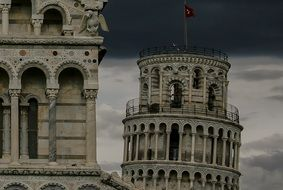 top of leaning tower at stormy sky, italy, pisa