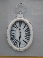 vintage oval hanging clocks on wall