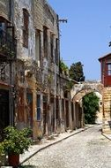 old ruined houses at cobblestone pavement, greece, rhodes