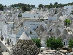 roof view of trulli, dry stone huts with a conical roof, in old town, italy, alberobello