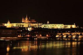 prague night castle lights city river reflection