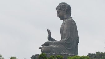 buddha statue at grey sky, china, hong kong