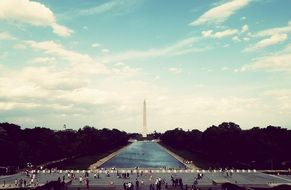 people in view of Washington Monument obelisk on the National Mall, usa, washington dc