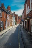 old red brick buildings on narrow street, uk, england, winchester
