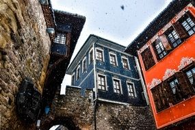 the old town first snow plovdiv orange blue buildings