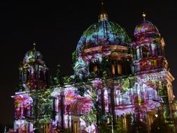 colorful lighting on facade of Cathedral, germany, berlin