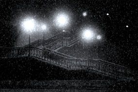 lamp posts at staircase on night streen in snowy winter