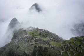 clouds over the ancient monument of unesco- Machu Picchu