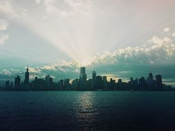 sunbeams burst through clouds above city skyline, usa, Illinois, chicago
