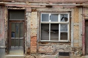old demolition house with broken window