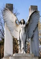 winged woman, stone sculpture on cemetery