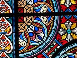 colorful pattern of stained glass window in basel cathedral, switzerland