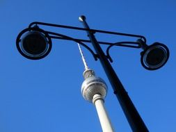 street lantern and top of tv tower at sky, germany, berlin