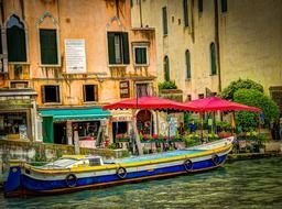 colorful boat on canal grande, italy, venice