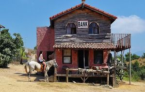girl horseback at old building