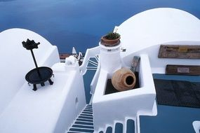 blue staircase in white village house, greece, santorini island