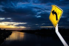 night view river cloudy sky traffic sign