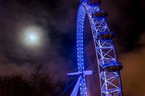 london eye, purple ferris wheel at dark night sky, uk, england