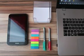 home office tablet laptop colourful stickers pens