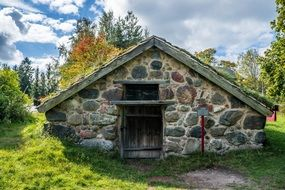 traditional stone house in autumn park, sweden, skansen