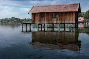 wooden boat house on ammersee lake, germany, bavaria