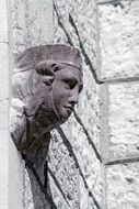 carved stone head old architecture