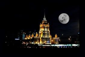 full moon above night city, russia, moscow