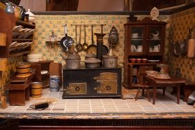 kitchen of antique dolls house, interior with stove, furniture and kitchenware