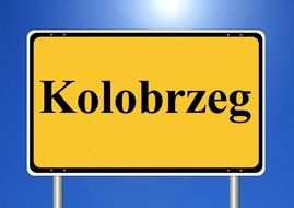 kolobrzeg yellow town sign