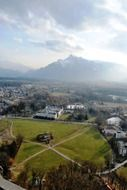 beautiful aerial view of castle and old town at mountains, austria, salzburg