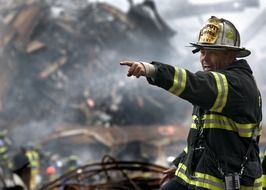 uniformed firefighter pointing straight