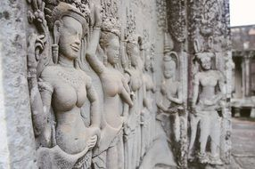 stone carved sculptures of angkor wat temple, cambodia