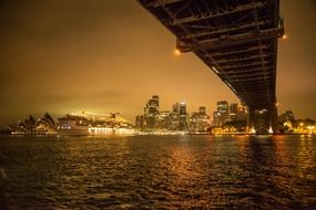 night cityscape with cruise ship at opera house, australia, sydney