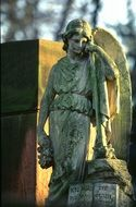 angel, old sculpture on cemetery