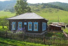 painted farm house, russia, altai