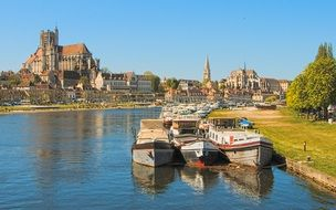 boats on water in view of old city at yonne river, france, auxerre