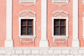 old dusky pink painted facade with grated windows, germany, Wasserburg am Inn