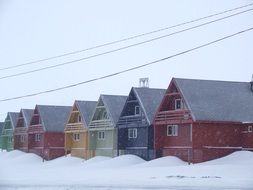 new colorful houses in snow, norway