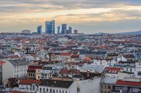 colorful roofs of city at evening, austria, vienna