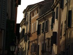 windows with shutters on old facade, croatia, rovinj