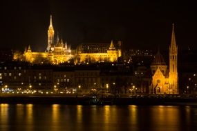 castle on danube river at night, hungary, budapest