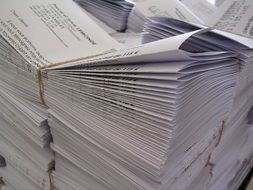 pile of folded paper with black printing