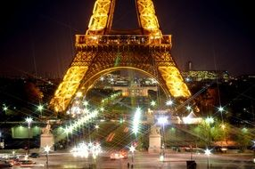beautiful night lights in city at eiffel tower, france, paris