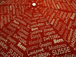 red umbrella with swiss cities names